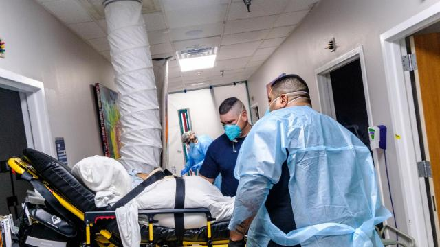 A patient is admitted to the COVID-19 ICU ward of United Memorial Medical Center in Houston, Nov. 26, 2020. Months into the pandemic, doctors and nurses know more than ever about how to treat COVID-19 patients. But the death toll is once again closing in on the high-water mark, set on April 15, of 2,752 deaths in a single day. (Christopher Lee/The New York Times)