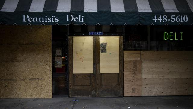 A boarded-up deli in downtown Sacramento, Calif., Dec. 5, 2020. (Max Whittaker/The New York Times)