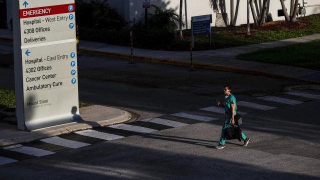 FILE -- A health care worker arrives at Mount Sinai Medical Center in Miami Beach, Fla., on July 3, 2020. Health authorities are investigating the case of a Florida doctor who died from an unusually severe blood disorder 16 days after receiving the Pfizer-BioNTech COVID-19 vaccine at Mount Sinai Medical Center on Dec. 18, 2020, and died 16 days later from a brain hemorrhage. (Scott McIntyre/The New York Times)
