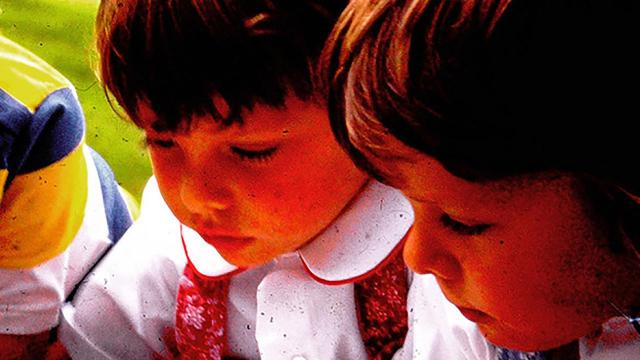 An undated family photo shows twins Marion, left, and Anita Pepper, age 3, observing ants. Anita Pepper is a developmental biologist at The Wistar Institute in Philadelphia, while her sister Marion Pepper is an immunologist at the University of Washington. (Anita Pepper via The New York Times) -- NO SALES; FOR EDITORIAL USE ONLY WITH NYT STORY SLUGGED SCI VIRUS GENETICS BY KATHERINE J. WU FOR JAN. 18, 2020. ALL OTHER USE PROHIBITED. --