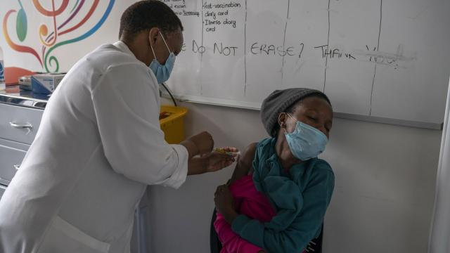 FILE -- A participant in a Novavax COVID-19 vaccine trial receives an injection at Wits RHI Shandukani Research Centre in Johannesburg on Dec. 8, 2020. Moderna's vaccine is effective against new variants of the coronavirus that have emerged in Britain and South Africa, the company announced on Monday, Jan. 25, 2021. (Joao Silva/The New York Times)