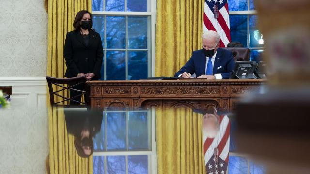 FILE -- President Joe Biden signs executive orders on immigration policy, as Vice President Kamala Harris looks on, at the White House in Washington, Feb. 2, 2021. Hundreds of little-noticed but consequential revisions to the immigration system will remain in place unless Biden's team specifically looks for — and roots out — the Trump administration's anti-immigrant policy changes. (Doug Mills/The New York Times)