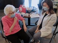 Sweet moment: Granddaughter personally vaccinates grandparents