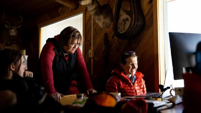 Kenna Tanner, left, Tip Top Search and Rescue's only full-time employee, in Cora, Wyo., on March 12, 2021. The rest of Tip Top's 40-odd staff members are local outdoors enthusiasts. (Max Whittaker/The New York Times)
