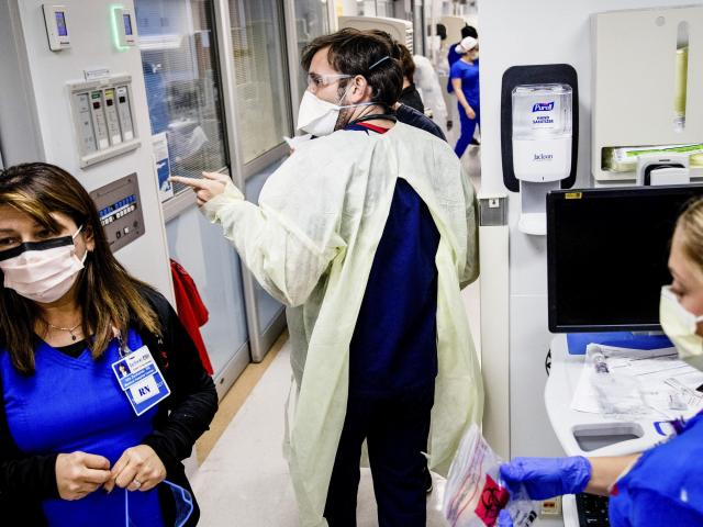 Inside a COVID ICU, Hopes Fade as Patients Surge In