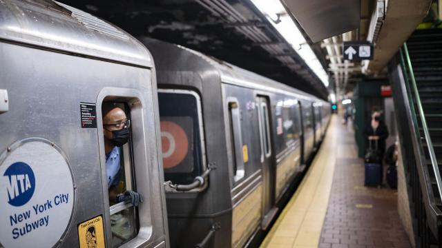 FILE — A New York City Subway train in Harlem on May 17, 2021. New York's Metropolitan Transportation Authority plans to extend a $500,000 death benefit to its employees who die of Covid-related causes through the end of 2021, a senior authority official said Monday, Sept. 13, 2021. But the benefit will remain unavailable to those who decline to get vaccinated against the coronavirus. (Karsten Moran/The New York Times)