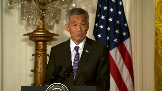 Singapore PM apologizes for family feud but denies siblings' allegations