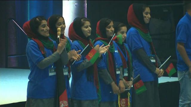 The girls walked on stage at the First Global Challenge, a competition in which teams from around the world maneuver a robot to collect and sort balls.
