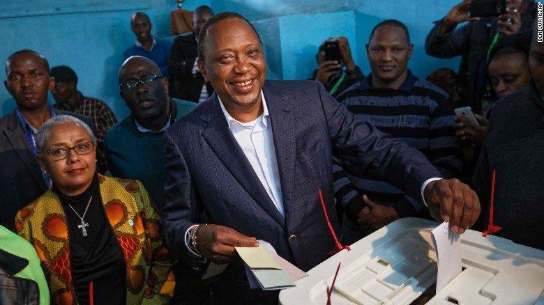 Kenyan incumbent President Uhuru Kenyatta casts his vote alongside his wife Margaret on Tuesday, August 9, 2017.