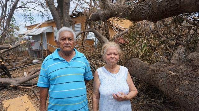 Jose Diaz and Lydia Pabon outside their severely damaged home in Ponce, Puerto Rico.