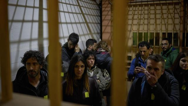 Visitors tour the Modelo, the century-old prison in Barcelona, Spain, Nov. 24, 2017. The prison was closed in June, but as the most recent political conflict with Spain's government intensified, Catalan authorities have been highlighting its history. (Samuel Aranda/The New York Times)