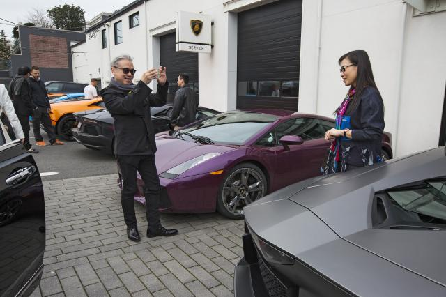 FILE -- Paul Se Hui Oei and his wife Loretta Lai at a Lamborghini dealership in Vancouver, Canada, March 19, 2016. In a case that highlights Canada's struggle to quash financial crime, a British Columbia Securities Commission panel announced Dec. 13, 2017, that Oei, a prominent immigration consultant and philanthropist, ran an elaborate fraud scheme, pocketing nearly $6 million from investors, including many Chinese citizens led to believe their investment would help them secure permanent Canadian residency. (Ruth Fremson/The New York Times)