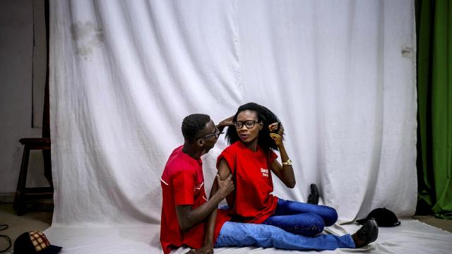 Lillian Usa and her boyfriend Moses Mshelia in a photo studio popular with couples, in Maiduguri, Nigeria, Feb. 15, 2017. To much of the world, the city is simply known as the embattled birthplace of Boko Haram, but there is another Maiduguri entirely, one where young women are pushing back, going to all-night parties and expecting husbands who do the dishes. (Ashley Gilbertson/The New York Times)