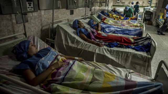 Women wait to be surgically sterilized at a free event at the state-run José Gregorio Hernández Hospital in Caracas, Venezuela, July 8, 2017. All of the women, who ranged from 25 to 32 years old, said they already had children and wanted to be sterilized because the economic crisis had made it too difficult to raise children. (Meridith Kohut/The New York Times)