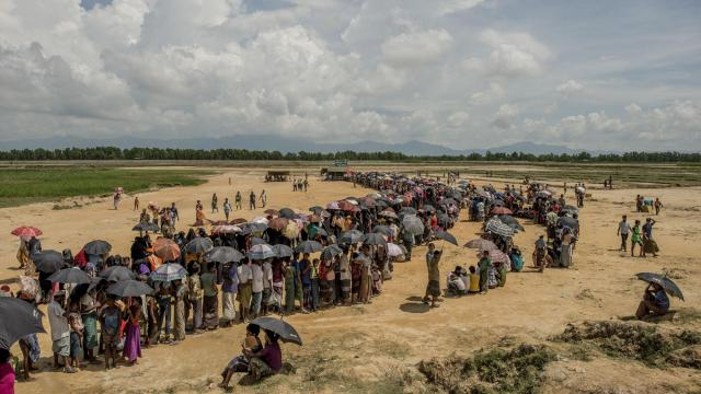 FILE -- Refugees line up to register near the Nayapara refugee camp in Cox's Bazar, Bangladesh, Sept. 26, 2017. Akayed Ullah, the suspect in last week's New York City attempted subway attack, rode a bus across Bangladesh to deliver aid to Rohingya refugees, then flew back to New York. (Tomas Munita/The New York Times)