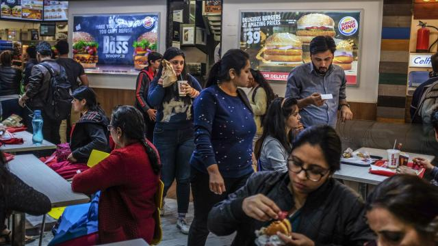 People eat at a Burger King in New Delhi, Nov. 25, 2017. The International Diabetes Federation projects that the number of Indians with diabetes will soar to 123 million by 2040 as diets rich in carbohydrates and fat spread to less affluent rural areas. (Atul Loke/The New York Times)
