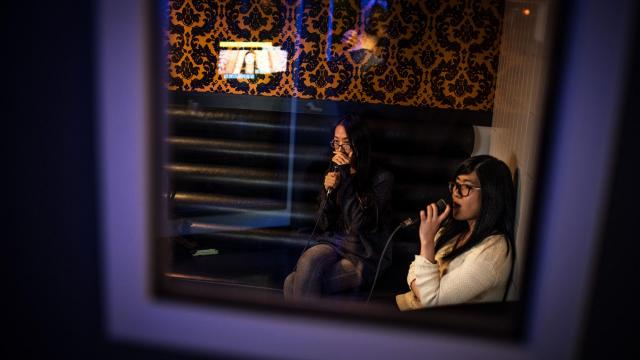 Friends Sylvia, left, and Sherry sing at Party World KTV, a branch of the Asian karaoke chain, in Richmond, British Columbia, Dec. 16, 2017. With thousands of songs in Mandarin and Cantonese, the Richmond satellite of Party World, long a karaoke staple across China, is a microcosm of Canada's shifting urban cultural landscape. (Aaron Vincent Elkaim/The New York Times).