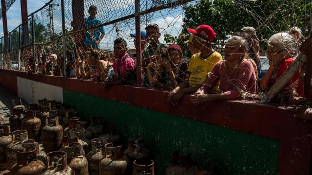 Residents of Amuay, Venezuela, a fishing village near a large oil refinery, line up in hopes of securing more fuel, Dec. 9, 2017. Pdvsa, Venezuela's state-owned oil company, has been so crippled by mismanagement and equipment shortages that the country with the world's largest proven oil reserves has resorted to importing fuel. (Meridith Kohut/The New York Times)