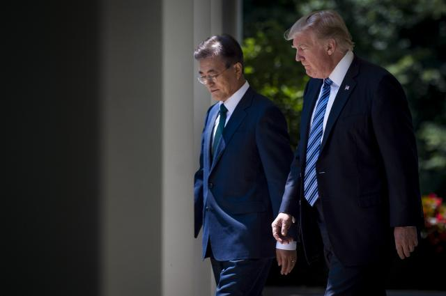 FILE — President Donald Trump and South Korean President Moon Jae-in walk from the Oval Office to the Rose Garden to deliver joint statements at the White House in Washington, June 30, 2017. The Trump administration doesn't oppose Korean peninsula diplomatic talks but is wary that Pyongyang will drive a wedge between Washington and Seoul. (Pete Marovich/The New York Times)