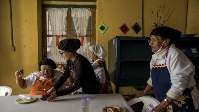 "Maria Norma Ruiz Sánchez, left, gets a cake on her 65th birthday, at Casa Xochiquetzal in Mexico City, Dec. 15, 2017. The group home is a haven for retired prostitutes looking to live with dignity after years scarred by violence, abuse, damage and loss. ""This house saved me,"" said Sanchez, who is still scarred from a rape at knifepoint at age 9. (Adriana Zehbrauskas/The New York Times)"