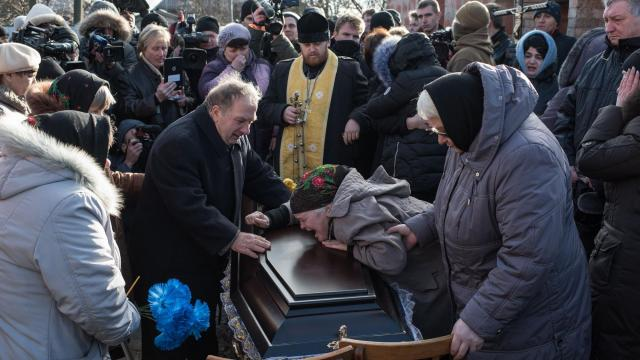 Kateryna Dunyak cries over the coffin of her daughter, the anti-corruption activist Iryna Nozdrovska, in Demydiv, Ukraine, Jan. 9, 2018. Nozdrovska's crusade for justice for her late sister was hailed in the Ukrainian media as an important victory for the rule of law. But on New Year's Day her body was found stabbed and floating in an icy river outside Kiev. (Alexey Furman/The New York Times)