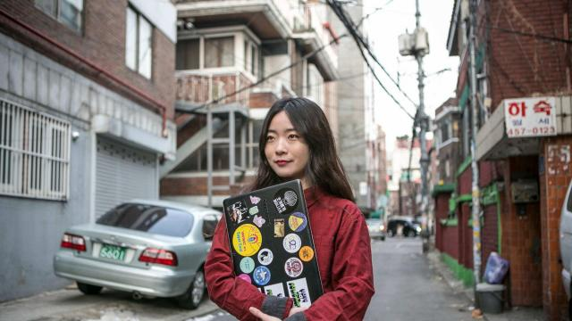 Lee Na-yeon, a philosophy major who had an abortion five years ago, holds a laptop case showing her support for women's causes in Seoul, South Korea, Dec. 14, 2017. Lee wants South Korea's ban on the procedure lifted so that other women won't go through the anguish she did. (Jean Chung/The New York Times)