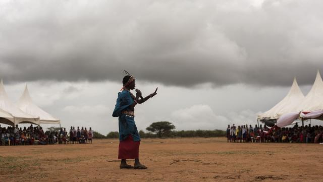 A Maasai girl tells her community why rite-of-passage ceremonies are important to replace female genital cutting, in Lenkisem, Kenya, Dec. 8, 2017. As a young girl, Nice Leng'ete hid to avoid the mutilation. Now 27, she runs a program going village to village, spreading a new rite of passage that has helped some 50,000 girls avoid the cutting ritual. (Andrea Bruce/The New York Times)