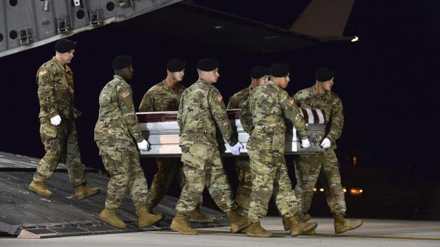 In a photo provided by the U.S. Air Force, the casket of Staff Sgt. Dustin Wright, who was killed by extremists in an Oct. 4 ambush in Niger, is returned to Dover Air Force Base in Delaware, Oct. 5, 2017. A draft military investigation into the deadly ambush calls for the Pentagon to scale back the number of ground missions in West Africa. (Staff Sgt. Aaron J. Jenne/U.S. Air Force via The New York Times) -- FOR EDITORIAL USE ONLY --