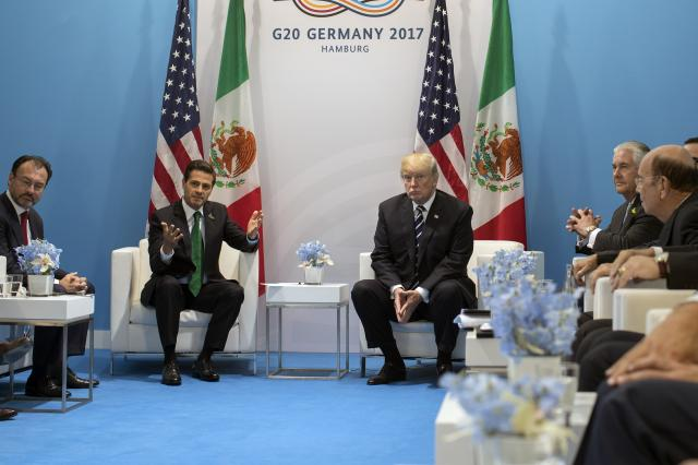 FILE — President Donald Trump meets with Mexican President Enrique Peña Nieto at the Group of 20 summit meeting in Hamburg, Germany, July 7, 2017. Trump's refusal to publicly drop his demand that Mexico pay for a wall on the southern border has derailed tentative plans for Peña Nieto to make his first visit to the Trump White House in March 2018, after a contentious telephone call reinflamed tensions on the issue. (Stephen Crowley/The New York Times)