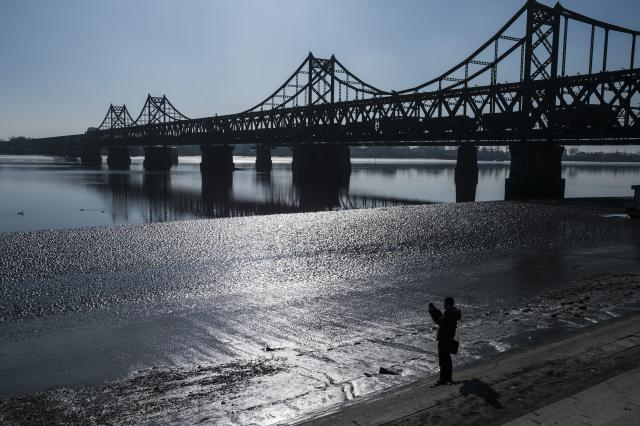 FILE -- The Sino-Korean Friendship bridge in Dandong, China, which connects China with North Korea, Dec. 25, 2018. President Donald Trump wants to maintain sanctions until North Korea disarms, but the buoyant mood in Dandong is a reminder that China, as North Korea's main trade partner, can decide how strictly to enforce the international sanctions against it. (Lam Yik Fei/The New York Times)