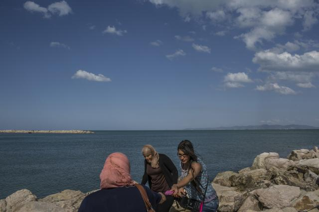 FILE -- Women on a beach in the La Goulette neighborhood of Tunis, Tunisia, May 23, 2015. A new law in Tunisia obliges any witness of violence against women to report it, and urged the opening of new shelters and other facilities to protect women in emergency situations. (Mauricio Lima/The New York Times)