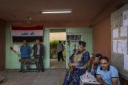 IMAGES: Freed From War, Iraqi Voters Focus on the Struggle of Daily Life