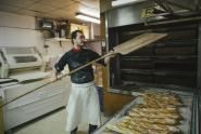 IMAGES: Sons of Immigrants Prop Up a Symbol of 'Frenchness': The Baguette