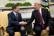 IMAGES: Trump Backs Off Demand That Kim Give Up Weapons