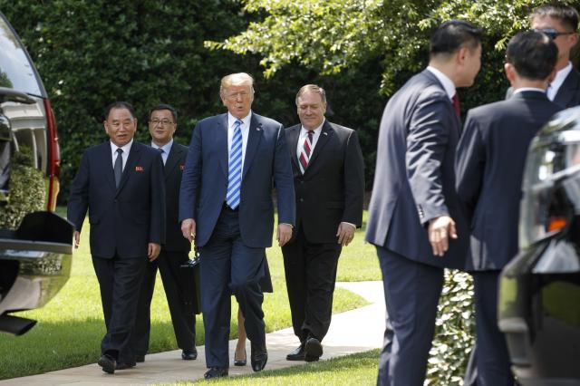 President Donald Trump with Kim Yong-chol, far left, the former North Korean intelligence chief and top nuclear arms negotiator, and Secretary of State Mike Pompeo, center, on the South Lawn of the White House in Washington, June 1, 2018. Planning the coming summit meeting between President Trump and Kim Jong-un to discuss North Korea's nuclear future will require deciding countless, infinitesimal details, often via tricky diplomatic negotiations. (Tom Brenner/The New York Times)