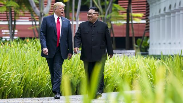 President Donald Trump and Kim Jong Un, the leader of North Korea, take a walk after their lunch on Sentosa Island in Singapore, June 12, 2018. Despite the fact that the United States and North Korea do not have formal diplomatic relations, all of the pageantry pointed to a meeting between near equals, a a masterful propaganda coup for the reclusive rogue state. (Doug Mills/The New York Times)