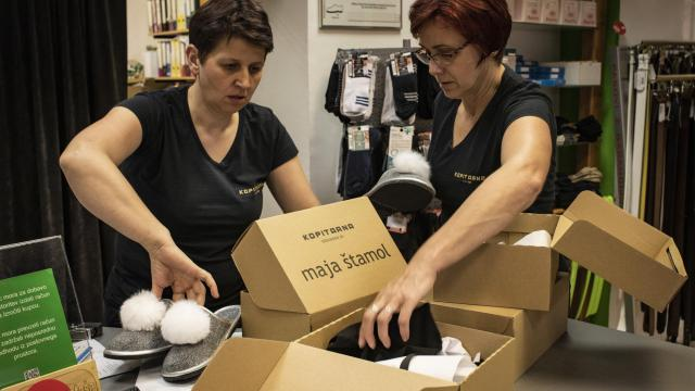 "Employees sort out pairs of ""White House"" slippers at the Kopitarna factory in Sevnica, Slovenia, May 24, 2018. There are few products that the enterprising burghers of Sevnica, a small, rural Slovenian town where Melania Trump spent her formative years, have not sought to brand in honor of the first lady of the United States. (Laura Boushnak/The New York Times)"