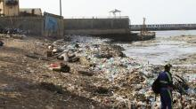 IMAGE: Wave after wave of garbage hits the Dominican Republic
