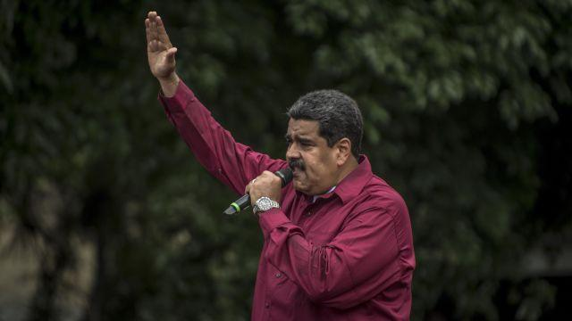 FILE -- Venezuelan President Nicolas Maduro speaks during a rally in Caracas, May 1, 2018. A drone attack that failed to kill President Maduro on August 4 unfolded on live TV and in front of many eyewitnesses in Caracas, who were watching the ceremony. (Meridith Kohut/The New York Times)