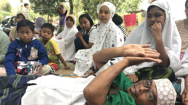 """Narto Aryadi, who spent more than 12 hours digging his way out of the Jabal Nur mosque after it collapsed from a major earthquake, in Lading-Lading, Indonesia, Aug. 7, 2018. """"When dawn came, I thanked God and I realized I will be alive,"""" Narto said. Narto, 43, is one of only a handful of survivors pulled from the rubble on the Indonesian resort island of Lombok after a magnitude 7.0 earthquake struck Sunday evening off the north coast. (Rick Paddock/The New York Times)"""