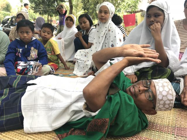 "Narto Aryadi, who spent more than 12 hours digging his way out of the Jabal Nur mosque after it collapsed from a major earthquake, in Lading-Lading, Indonesia, Aug. 7, 2018. ""When dawn came, I thanked God and I realized I will be alive,"" Narto said. Narto, 43, is one of only a handful of survivors pulled from the rubble on the Indonesian resort island of Lombok after a magnitude 7.0 earthquake struck Sunday evening off the north coast. (Rick Paddock/The New York Times)"