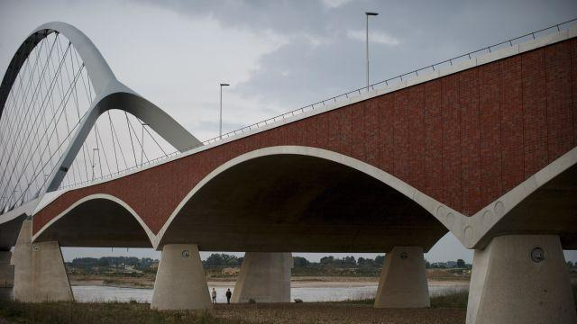 FILE -- The Oversteek Bridge on the Waal River in the Netherlands, Sept. 13, 2014. Despite years of warnings about underinvestment in European bridges, experts and governments cannot say for sure how serious the risk of collapse is. (Jasper Juinen/The New York Times)