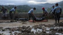 IMAGES: Drawn by Gold, Drowned in Mud: Typhoon Kills Philippine Miners