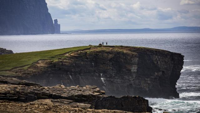 The landscape around Mainland, one of the Orkney Islands in Scotland, Aug. 1, 2018. In forays to remote spits of land, people are working to save some of these places for posterity from the climate changes accelerated by human activity. (Josh Haner/The New York Times)