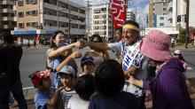 IMAGES: U.S. Marine's Son Wins Okinawa Election on Promise to Oppose Military Base