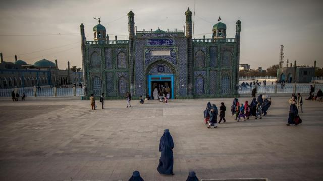 FILE -- Visitors gather at the Hazrat Ali shrine in Mazar-i-Sharif, Afghanistan, March 4, 2013. A man called Rasool Landay lured Afghan women into having sex with him to treat their infertility. He then filmed the encounters and extorted money. Officials fear some of the women may been killed by relatives. (Bryan Denton/The New York Times)