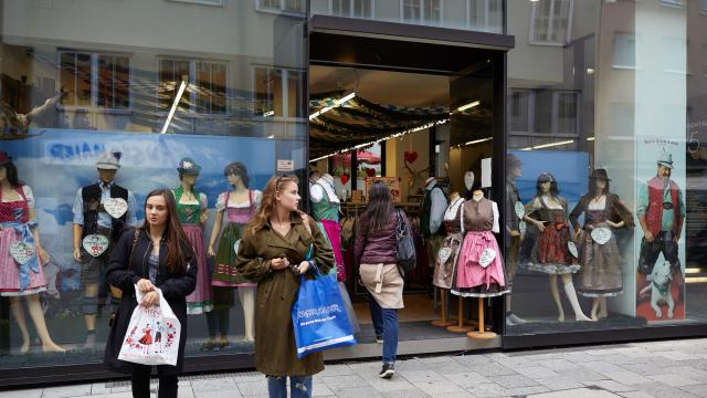 Two women stand outside a shop that sells dirndls for Oktoberfest, in Munich, Oct. 2, 2018. Not so long ago, the 19th-century peasant garb was considered the uniform of older, more conservative folk. Now it is all the rage with millennials. (Ksenia Kuleshova/The New York Times)