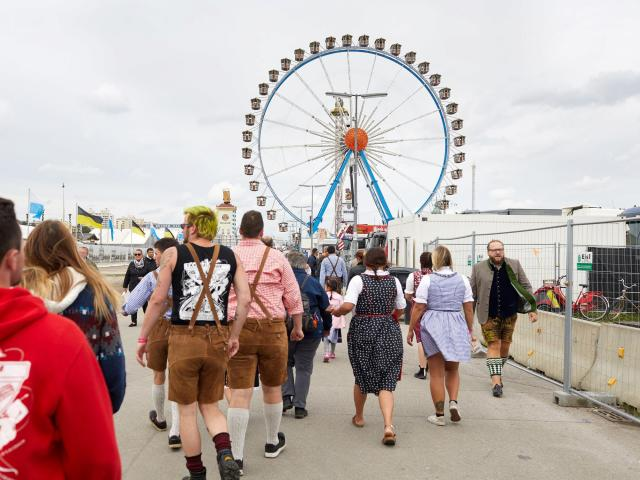 Young people go clubbing in dirndls and lederhosen after visiting Oktoberfest, in Munich, Oct. 2, 2018. Not so long ago, the 19th-century peasant garb was considered the uniform of older, more conservative folk. Now it is all the rage with millennials. (Ksenia Kuleshova/The New York Times)