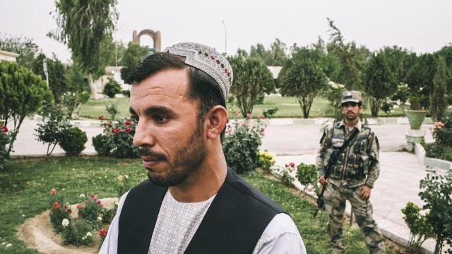 FILE-- Gen. Abdul Raziq, the police chief of Kandahar Province, shadowed at home by one of his many bodyguards, in Kandahar City, Afghanistan, May 6, 2015. Raziq, long seen as a bulwark against the Taliban, was killed on Oct. 18, 2018, Afghan officials confirmed. He was shot and killed as he was leaving a meeting in Kandahar City that was also attended by the commander of American forces in Afghanistan, Gen. Austin Miller, and the rest of the provincial leadership. (Bryan Denton/The New York Times)