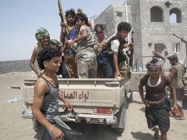 Yemeni fighters with the Saudi Arabia-led Arab coalition that is battling Iran-backed Houthis for control of Yemen near the front line by Hudaydah airport in Yemen, Oct. 3, 2018. The Saudi-led war in Yemen has lasted for more than three years, killing thousands of civilians and creating what the United Nations calls the world's worst humanitarian crisis. But it took the crisis over the apparent murder of the dissident journalist Jamal Khashoggi in a Saudi consulate two weeks ago for the world to take notice. (Tyler Hicks/The New York Times)